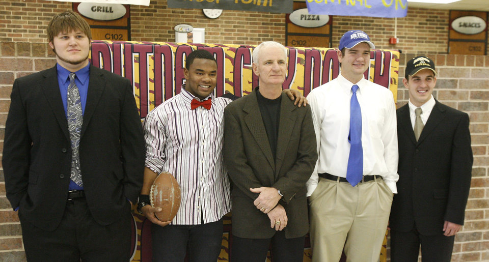 Photo - Coach Bob Wilson, center, poses with David Lamb, signing with the University of Central Okla., Josh Booker, signing to play for Weber State, Chris Jackson, signing with the Air Force Academy, and Hunter Frantz, signing with the Army Academy, during a signing ceremony at Putnam City North High School in Oklahoma City Wednesday, Feb. 4, 2009. BY PAUL B. SOUTHERLAND, THE OKLAHOMAN