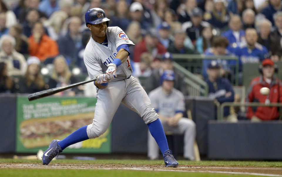 Photo - Chicago Cubs' Starlin Castro hits a home run against the Milwaukee Brewers during the second inning of a baseball game on Sunday, April 27, 2014, in Milwaukee. (AP Photo/Jeffrey Phelps)