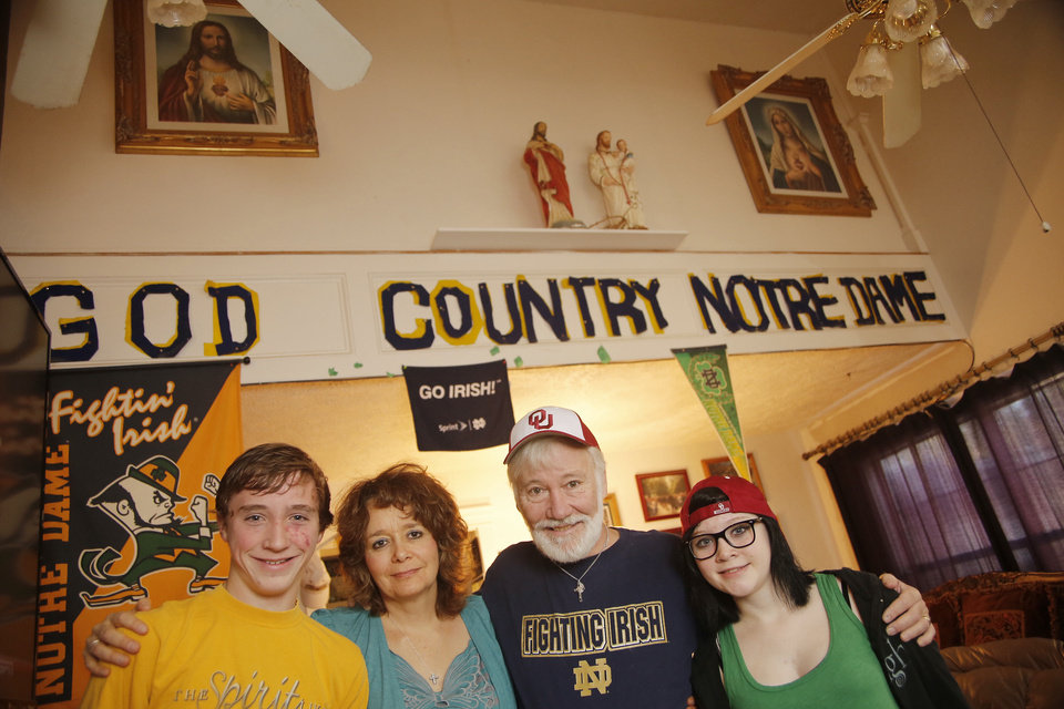 Notre Dame fans Cynthia and  Tim Flenniken stand with their 16-year-old  twins John and Hannah in the family's living room in Edmond. Photo by Doug Hoke, The Oklahoman <strong>DOUG HOKE - THE OKLAHOMAN</strong>