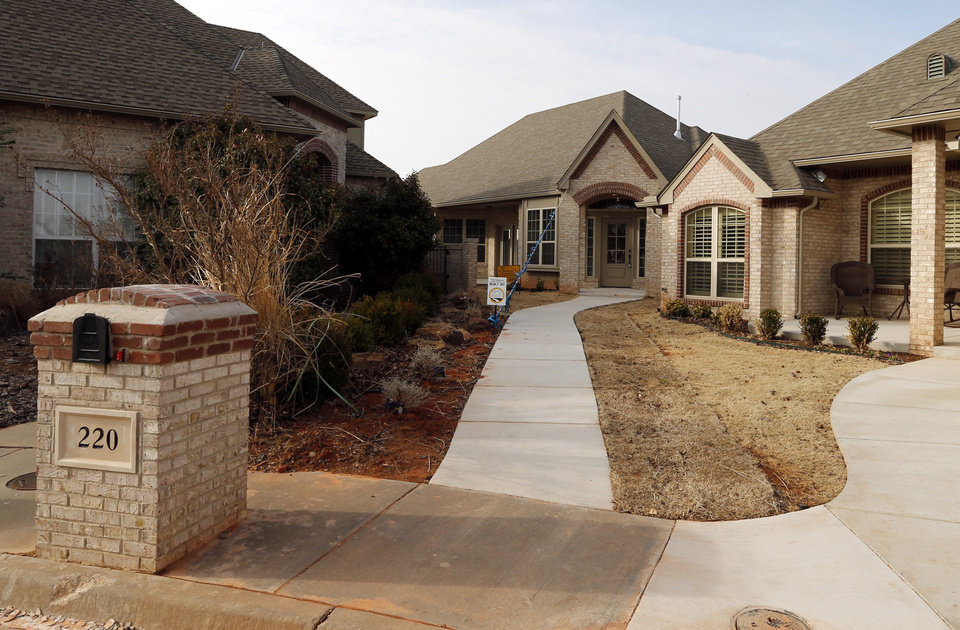 Photo - Builder Ali Farzaneh says his First Oklahoma Construction revived Norman's Summit Lake Villas addition by developing odd-shaped and zero-lot-line sites. This view shows the entry to the home at 220 Boulevard Du Lac.  Photos by Steve Sisney, The Oklahoman  STEVE SISNEY -