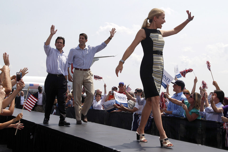 Republican vice presidential candidate Rep. Paul Ryan, R-Wis., center, and House Majority Leader Eric Cantor of Va., left, follow Ryan's wife Janna at a campaign event, Friday, Aug. 31, 2012, in Richmond, Va.  (AP Photo/Mary Altaffer)