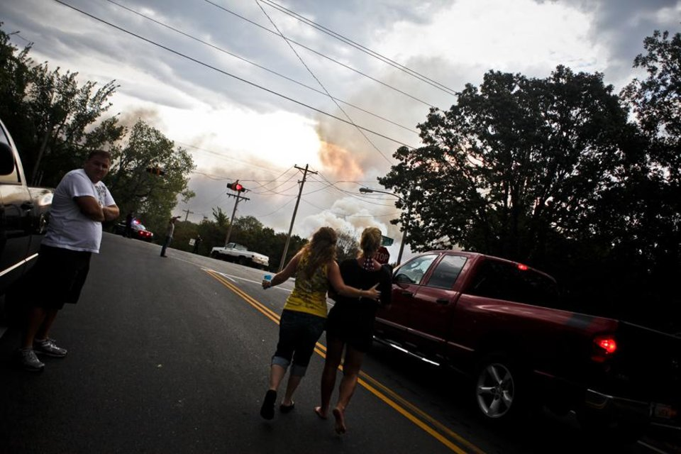 Photo -  WILDFIRE: Two women walk to further inspect a large fire in Edmond on Saturday, August 6, 2011. Photo by Zach Gray ORG XMIT: KOD