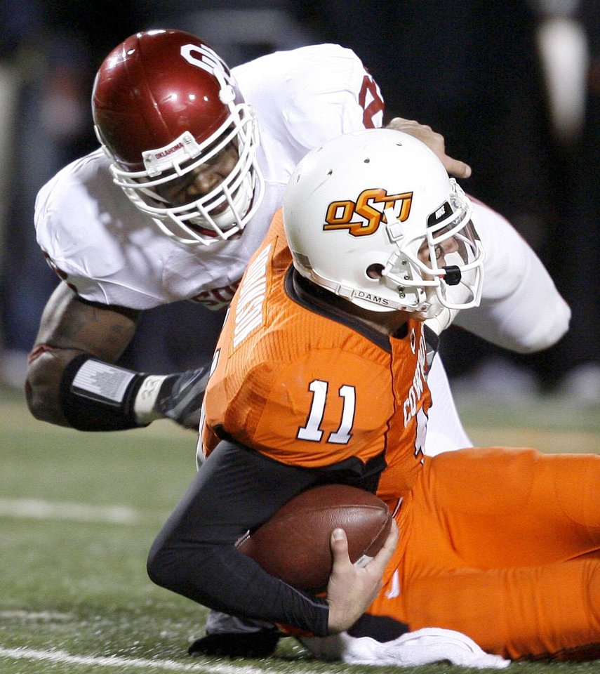 OU's Keenan Clayton sacks Zac Robinson of OSU during the college football game between the University of Oklahoma Sooners (OU) and Oklahoma State University Cowboys (OSU) at Boone Pickens Stadium on Saturday, Nov. 29, 2008, in Stillwater, Okla. STAFF PHOTO BY BRYAN TERRY