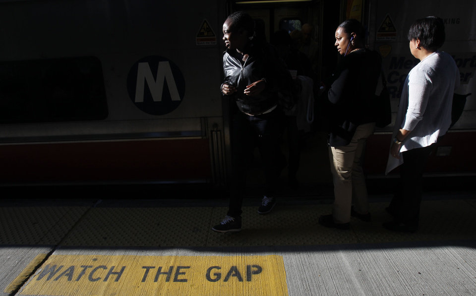 Photo - FILE - In this file photo taken Wednesday, Sept. 29, 2010, commuters exit and board a train bound for New York during the morning rush hour in Mt. Vernon, N.Y. Economists have long argued that rising economic inequality has held back the U.S. rebound from the Great Recession. Now, an analysis by the ratings agency Standard & Poor's confirms it: The widening gap between the wealthiest Americans and everyone else has made the economy more prone to boom-bust cycles and held back the rebound from the Great Recession. (AP Photo/Seth Wenig, File)