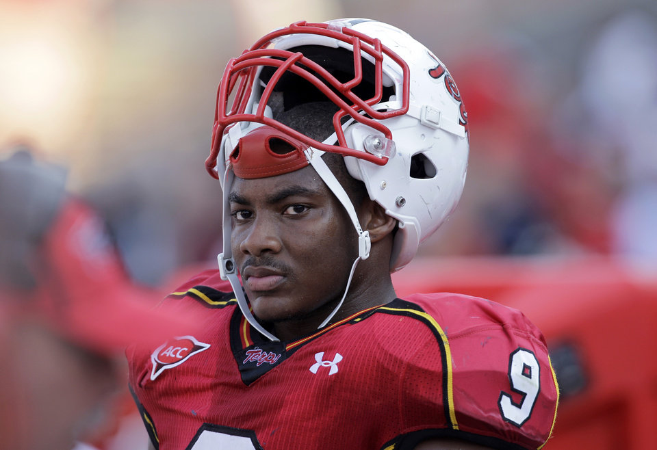 FILE - In this Sept. 9, 2010, file photo, Maryland linebacker Demetrius Hartsfield watches from the sideline during the second half of an NCAA college football game against Florida International in College Park, Md. Hartsfield is affectionately called