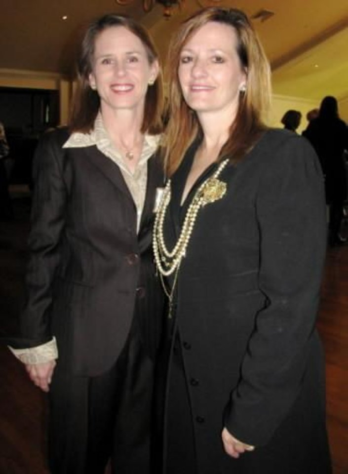 Left: Carol Joullian, Lee Ann Nordin at Theta Founders' Day. Photo provided.