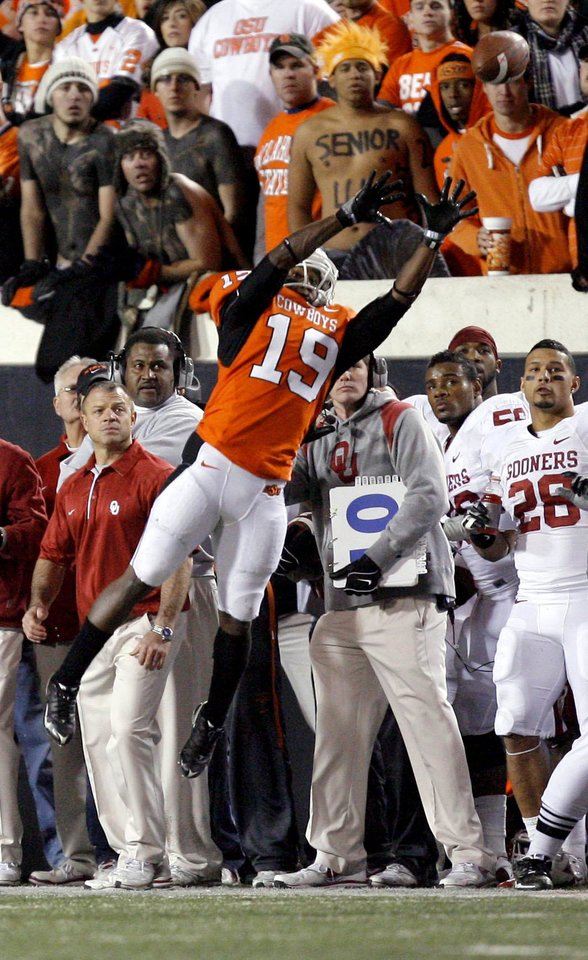 Photo - Oklahoma State's Brodrick Brown (19) tips a Oklahoma's Landry Jones  (12) pass in bounds during the Bedlam college football game between the University of Oklahoma Sooners (OU) and the Oklahoma State University Cowboys (OSU) at Boone Pickens Stadium in Stillwater, Okla., Saturday, Nov. 27, 2010. Photo by Sarah Phipps, The Oklahoman