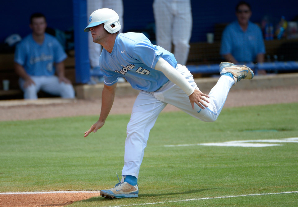 Photo - North Carolina's Alex Raburn stumbles on his way to home plate, but scores off a double by Tyler Ramirez during the seventh inning of an NCAA college baseball regional tournament game against Long Beach State in Gainesville, Fla., Monday, June 2, 2014. Long Beach State won 12-5.(AP Photo/Phelan M. Ebenhack)
