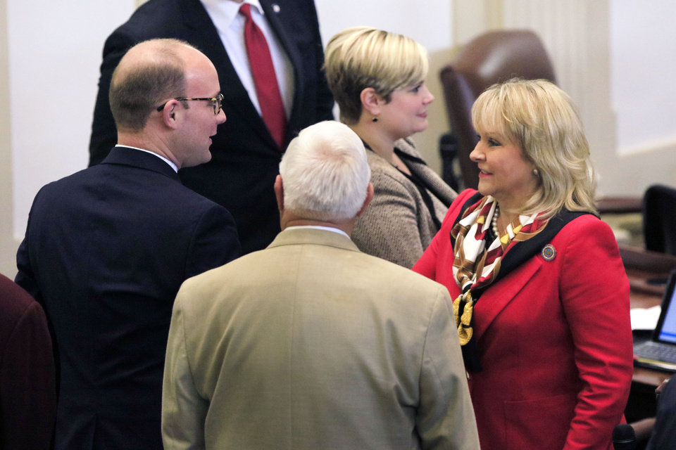Photo - Minority Leader Scott Inman greets Governor Mary Fallin after she delivered the State of the State address on the floor of the House of Representatives at the State Capitol in Oklahoma City, Okla. Monday, Feb. 6, 2017.  Photo by Paul Hellstern, The Oklahoman
