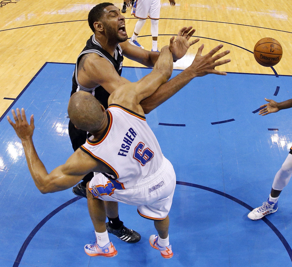 Photo - Oklahoma City's Derek Fisher (6) fouls San Antonio's Tim Duncan (21) during Game 6 of the Western Conference Finals in the NBA playoffs between the Oklahoma City Thunder and the San Antonio Spurs at Chesapeake Energy Arena in Oklahoma City, Saturday, May 31, 2014. Photo by Nate Billings, The Oklahoman