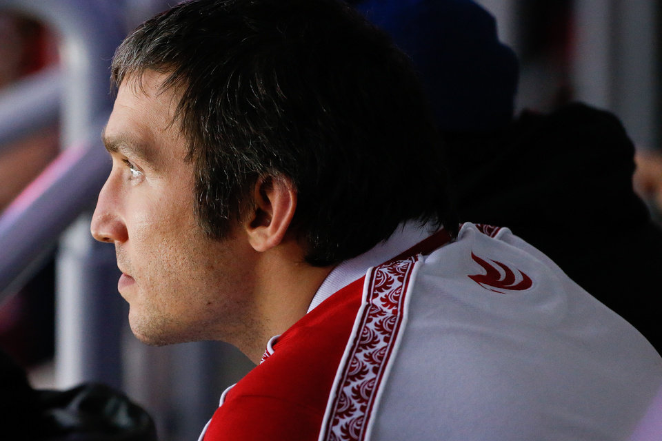 Photo - Russia forward Alexander Ovechkin watches the start of the men's semifinal ice hockey game between Canada and the United States at the 2014 Winter Olympics, Friday, Feb. 21, 2014, in Sochi, Russia. (AP Photo/Mark Humphrey)