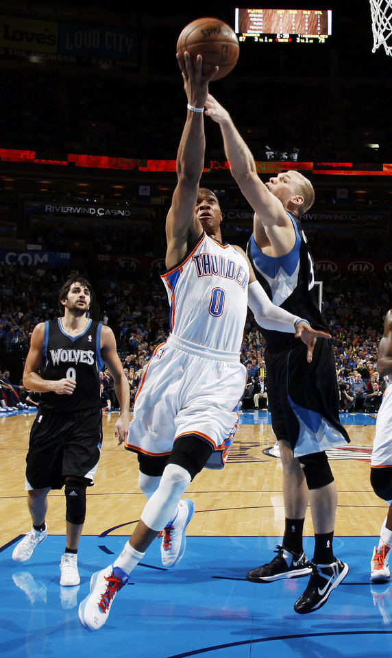 Oklahoma City\'s Russell Westbrook (0) takes the ball to the basket against Minnesota\'s Greg Stiemsma (34) in front of Ricky Rubio (9) during an NBA basketball game between the Oklahoma City Thunder and Minnesota Timberwolves at Chesapeake Energy Arena in Oklahoma City, Friday, Feb. 22, 2013. Oklahoma City won, 127-111. Photo by Nate Billings, The Oklahoman