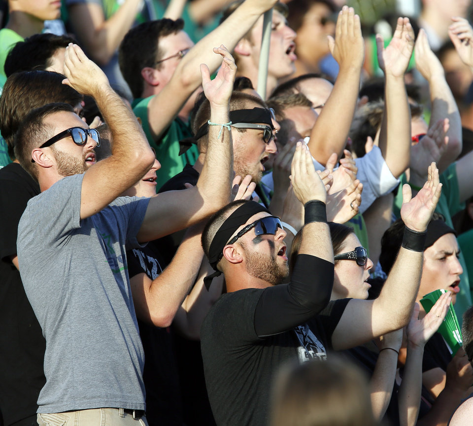 Photo - Oklahoma City fans cheer during a soccer game between the OKC Energy FC and LA Galaxy II at Pribil Stadium at Bishop McGuinness Catholic High School in Oklahoma City, Saturday, Aug. 16, 2014. Photo by Nate Billings, The Oklahoman