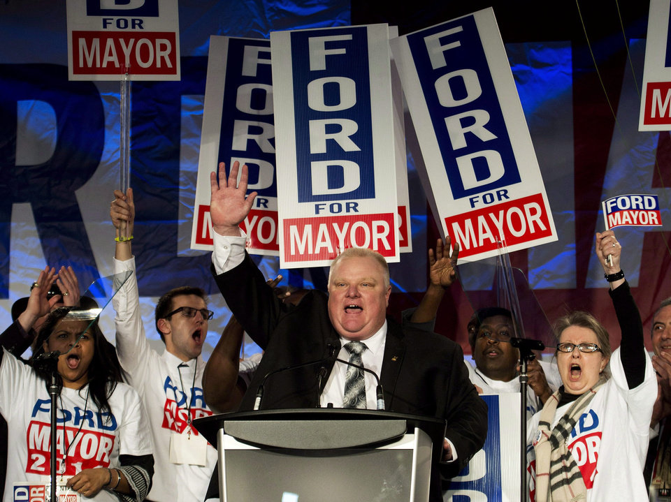 Photo - FILE - In this Thursday, April 17, 2014, file photo, Toronto mayor Rob Ford reacts as he speaks to his supporters during his campaign launch in Toronto. Rob Ford's lawyers  said on Wednesday, April 30, 2014, that Ford will take a leave of absence to seek help for substance abuse. (AP Photo/The Canadian Press, Nathan Denette, File)