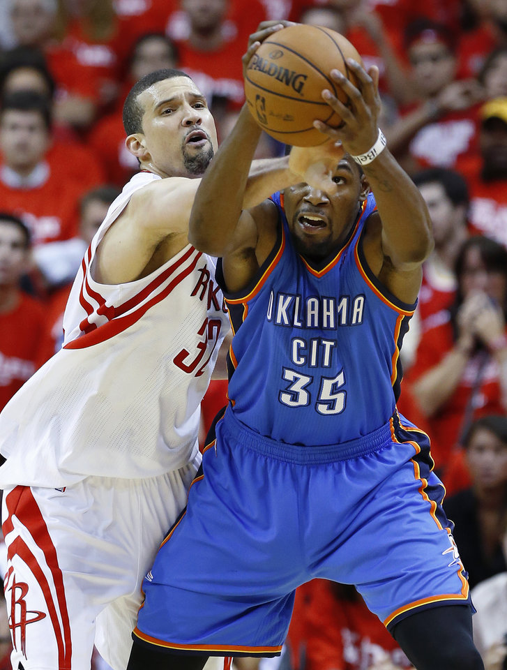 Photo - Oklahoma City's Kevin Durant (35) goes for the ball beside Houston's Houston's Francisco Garcia (32) during Game 6 in the first round of the NBA playoffs between the Oklahoma City Thunder and the Houston Rockets at the Toyota Center in Houston, Texas, Friday, May 3, 2013. Oklahoma City won 103-94. Photo by Bryan Terry, The Oklahoman