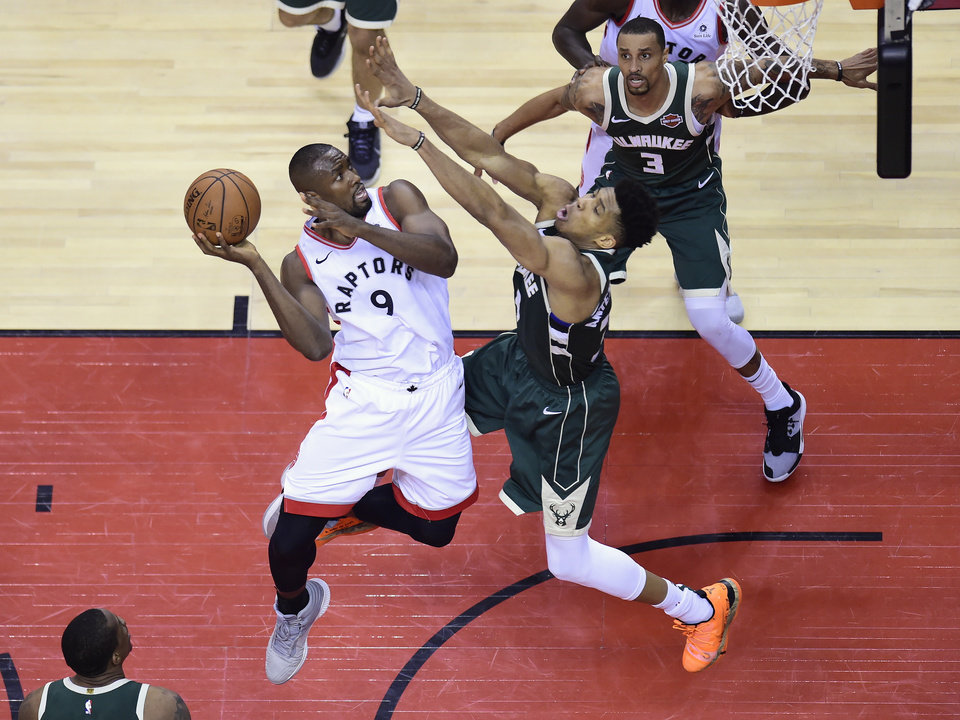 Photo - Toronto Raptors centre Serge Ibaka (9) goes the net as Milwaukee Bucks forward Giannis Antetokounmpo (34) defends during first half NBA Eastern Conference finals basketball action in Toronto on Sunday, May 19, 2019. (Frank Gunn/The Canadian Press via AP)