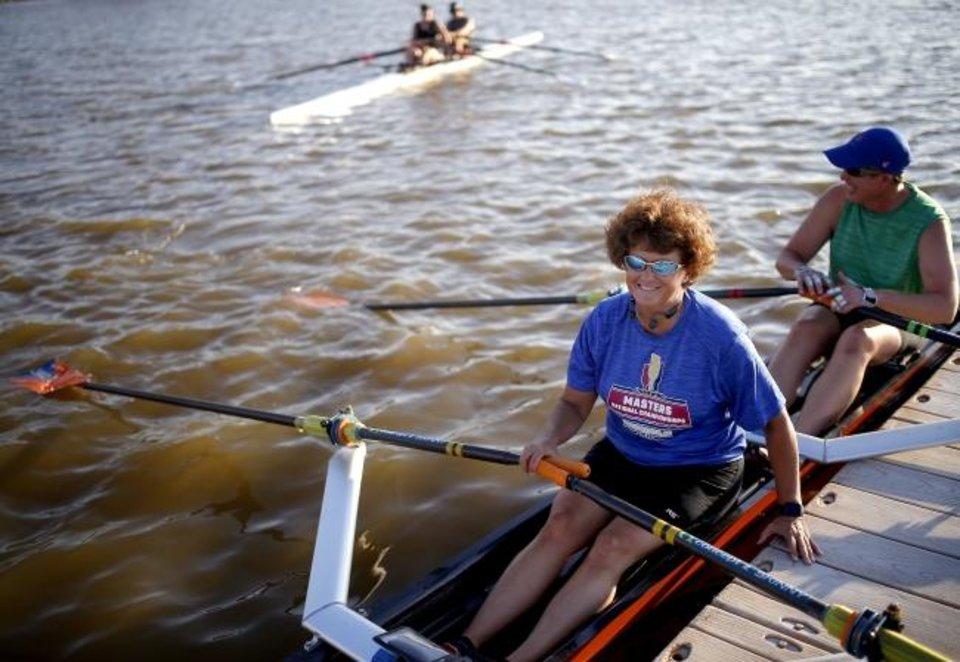 Photo -  Audrey Farnum, who is blind, and rowing partner Michelle Wald prepare to leave the dock at the Oklahoma River. The women won doubles in the inclusive category earlier this summer at the U.S. Rowing Masters National Championships in Grand Rapids, Michigan. [SARAH PHIPPS/THE OKLAHOMAN]