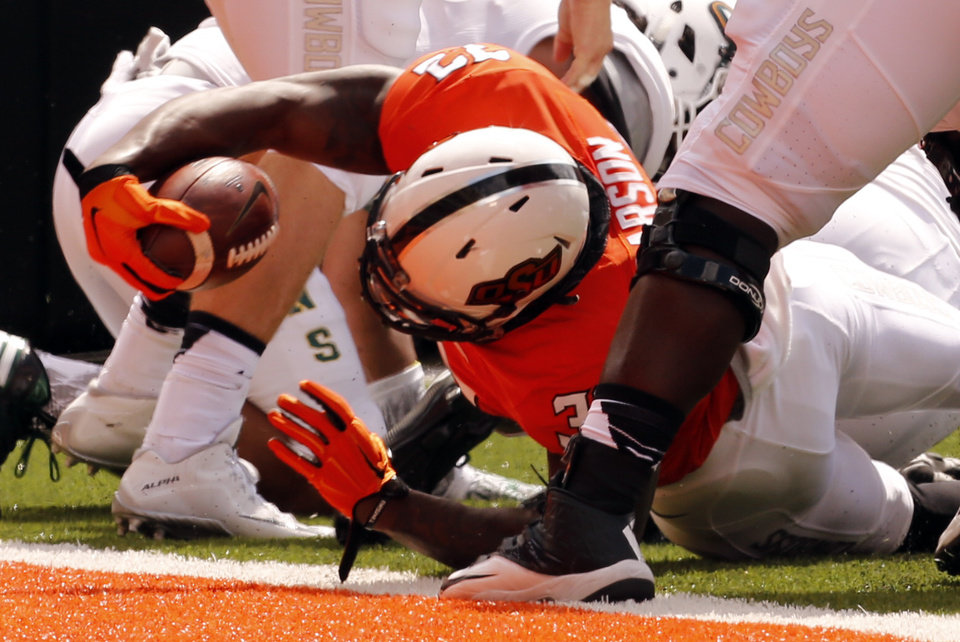 Photo - Oklahoma State's Chris Carson (32) scores during the college football game between the Oklahoma State Cowboys (OSU) and the Southeastern Louisiana Lions at Boone Pickens Stadium in Stillwater, Okla., Saturday, Sept. 12, 2015. Photo by Steve Sisney, The Oklahoman