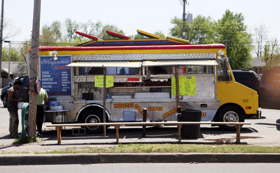 Photo - A food truck sells tacos to passers-by on SW 29 on Tuesday .  KT King -  The Oklahoman