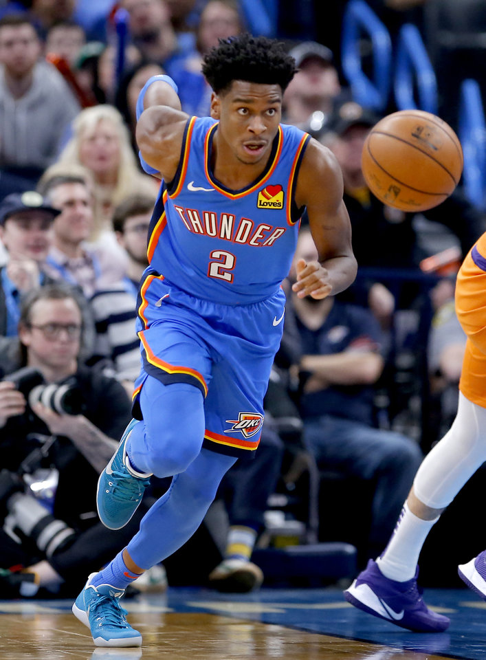 Photo - Oklahoma City's Shai Gilgeous-Alexander (2) gets turnover  during the NBA basketball game between the Oklahoma City Thunder and the Phoenix Suns at the Chesapeake Energy Arena in Oklahoma City , Friday, Dec. 20, 2019.   [Sarah Phipps/The Oklahoman]