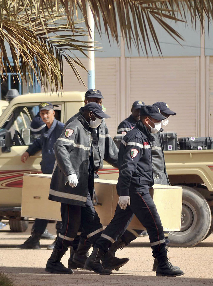 Photo - Algerian firemen carry a coffin containing the body of a person killed during the hostage situation in a gas plant at the morgue in Ain Amenas, Monday, Jan. 21, 2013. At least 81 people have been reported dead, including 32 Islamist militants, after a bloody, four-day hostage situation at Algeria's remote Ain Amenas natural gas plant. (AP Photo/Anis Belghoul)
