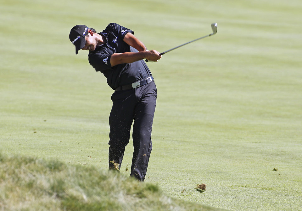 Photo - Jason Day hits his second shot on the 14th hole during the first round of the Deutsche Bank Championship golf tournament in Norton, Mass., Friday, Aug. 29, 2014. (AP Photo/Stew Milne)