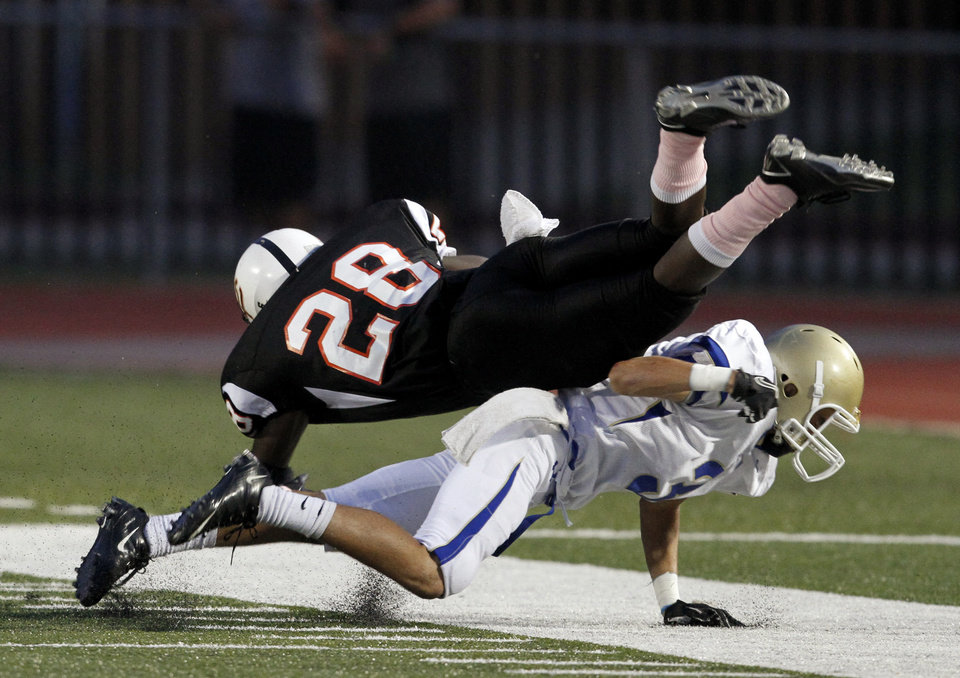 Photo - Choctaw's Bret Heinken brings down Desmond Tilly during a high school football game between Putnam City and Choctaw in Oklahoma CIty, Thursday, September 16,  2010.  Photo by Bryan Terry, The Oklahoman