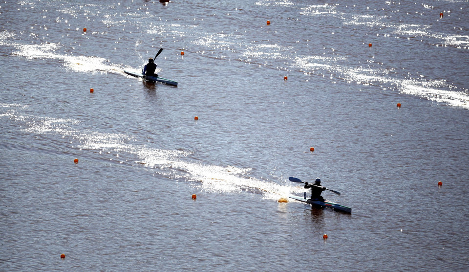 Kayakers compete during the Men\'s single Kayak 1000m Final A during races for the USA Canoe/Kayak World Cup Team Trials on the Oklahoma River, Saturday, April 21, 2012. Photo by Sarah Phipps, The Oklahoman.