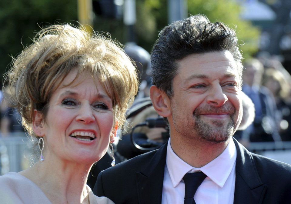Photo -   Cast member Andy Serkis, right, and his wife Loraine Ashbourne pose on the red carpet at the premiere of