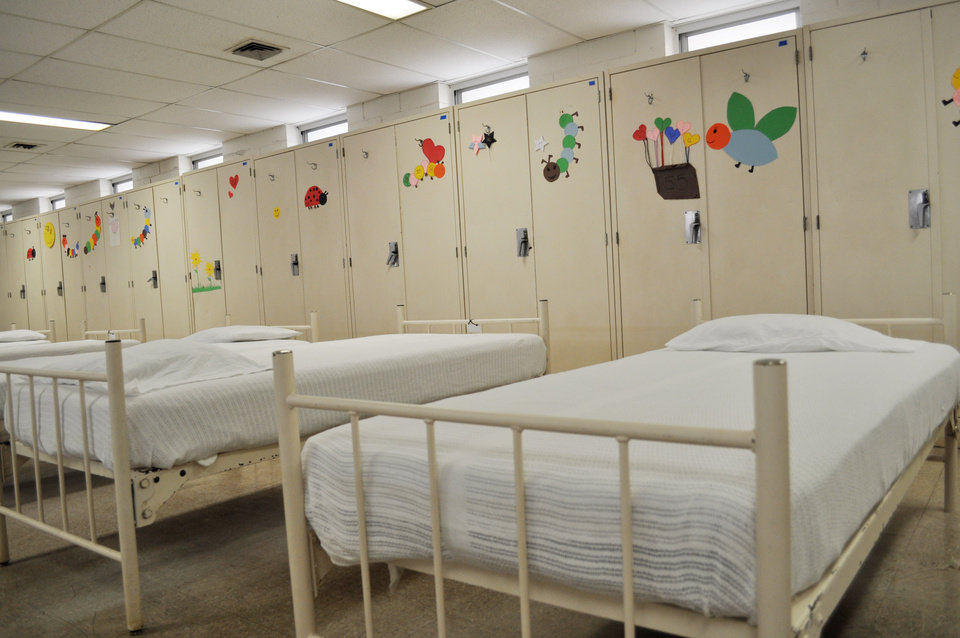 Photo -  Beds and lockers in one of the several dormitory rooms for immigrant minors at Fort Sill in Lawton. Photo provided    PROVIDED