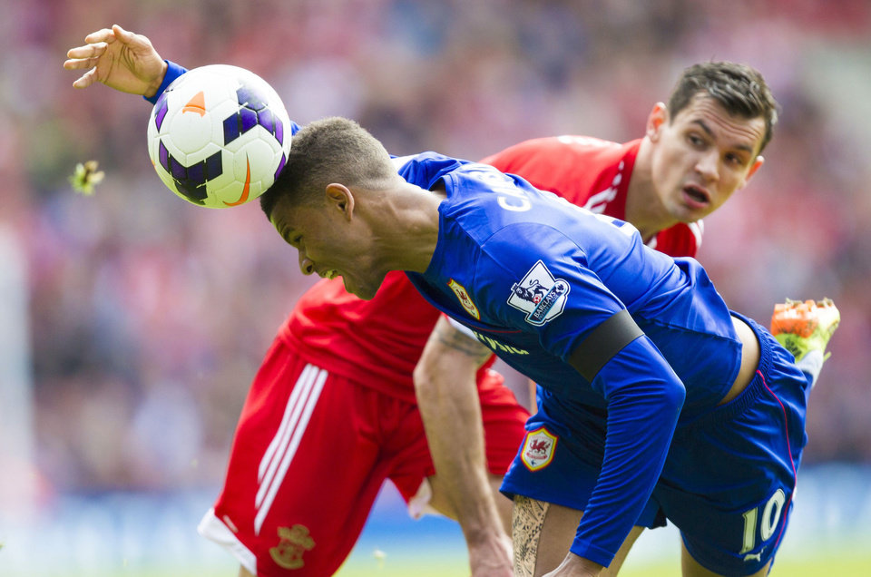 Photo - Southampton's Dejan Lovren, right, watches Cardiff City's Fraizer Campbell head the ball during their English Premier League soccer match at St Mary's, Southampton, England, Saturday April 12, 2014. (AP Photo/PA, Chris Ison) UNITED KINGDOM OUT  NO SALES  NO ARCHIVE