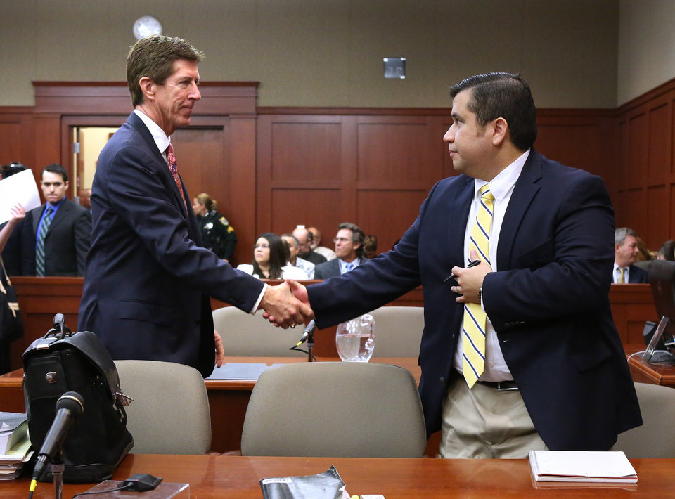 Photo - George Zimmerman, right, is greeted by his attorney, Mark O'Mara, before the start of the 15th day of his trial in Seminole circuit court, in Sanford, Fla., Friday, June 28, 2013. Zimmerman has been charged with second-degree murder for the 2012 shooting death of Trayvon Martin.(AP Photo/Orlando Sentinel, Joe Burbank, Pool)