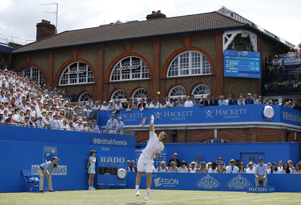 Photo - Andy Murray serves at The Queen's Club, grass-court tournament  in London Wednesday June 11, 2014, during his match against France's Paul-Henri Mathieu. (AP Photo/PA, Jonathan Brady) UNITED KINGDOM OUT  NO SALES  NO ARCHIVE