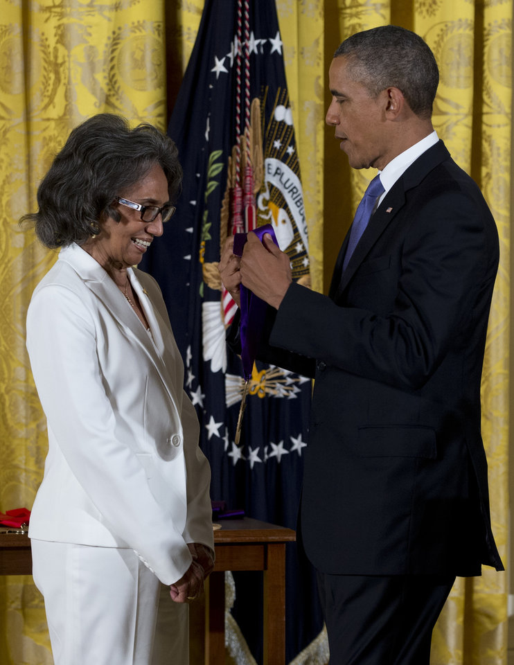 Photo - President Barack Obama awards Joan Myers Brown the 2012 National Medal of Arts, for her contributions as a dancer, choreographer, and artistic director, Wednesday, July 10, 2013, during a ceremony in the East Room of White House in Washington.  (AP Photo/Carolyn Kaster