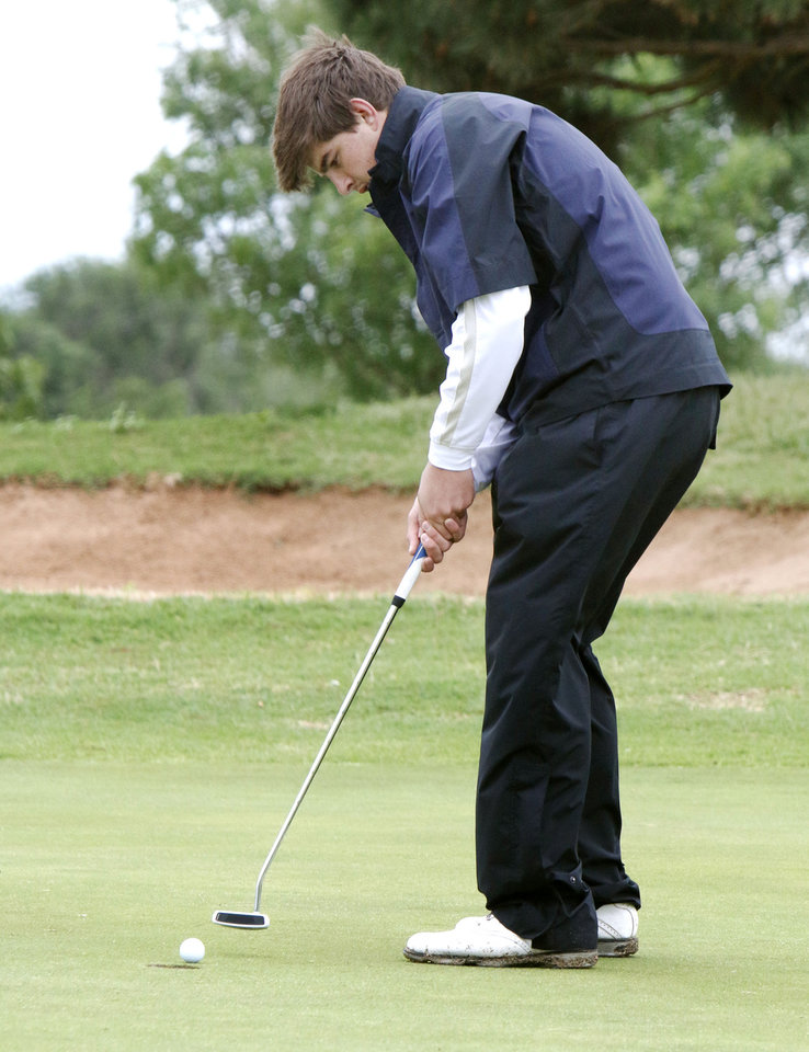 Photo - Weatherford's Quade Cummins hits a putt during the class 4A boy's state golf tournament at the Lake Hefner Golf Course in Oklahoma City, OK, Monday, May 12, 2014,  Photo by Paul Hellstern, The Oklahoman