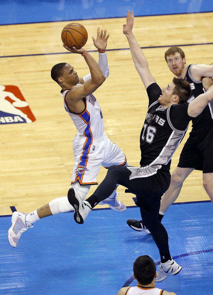 Photo - Oklahoma City's Russell Westbrook (0) goes up for a basket as San Antonio's Aron Baynes (16) defends during Game 4 of the Western Conference Finals in the NBA playoffs between the Oklahoma City Thunder and the San Antonio Spurs at Chesapeake Energy Arena in Oklahoma City, Tuesday, May 27, 2014. Photo by Bryan Terry, The Oklahoman