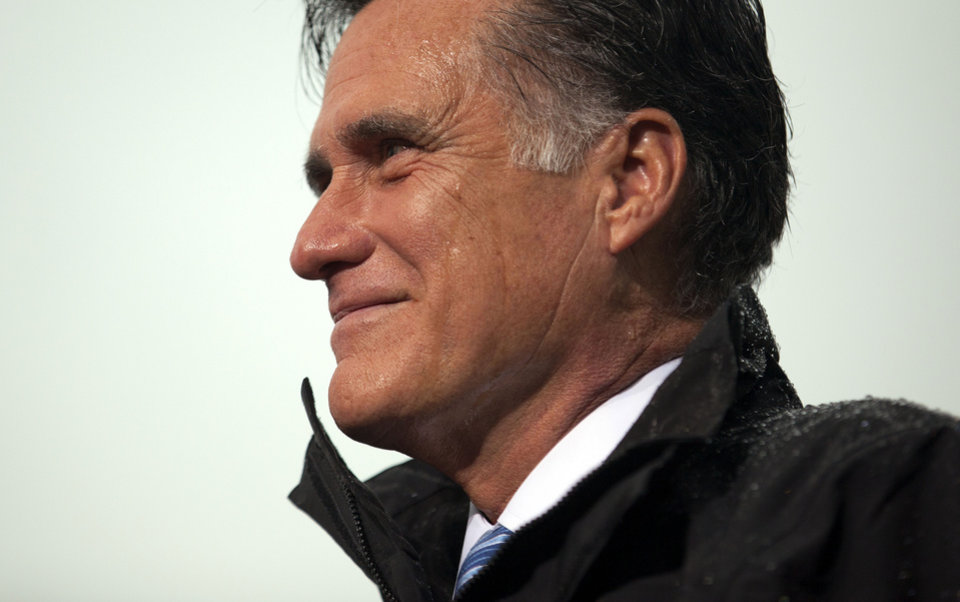 Photo -   Republican presidential candidate, former Massachusetts Gov. Mitt Romney pauses during a campaign rally on Monday, Oct. 8, 2012, in Newport News, Va. (AP Photo/ Evan Vucci)