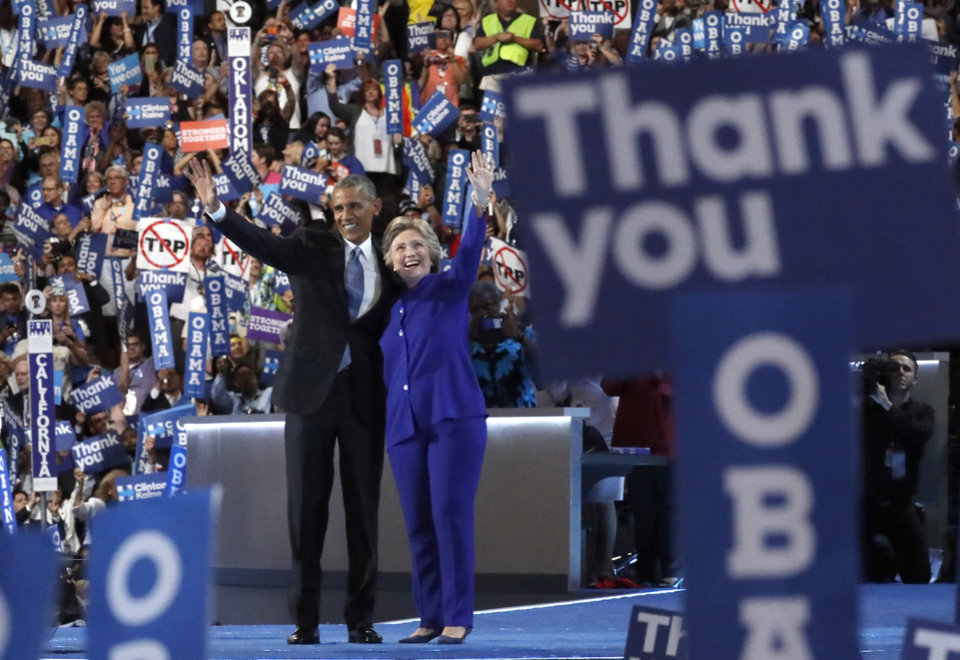 Photo - President Barack Obama and Democratic Presidential candidate Hillary Clinton wave together on the third day of the Democratic National Convention in Philadelphia , Wednesday, July 27, 2016. (AP Photo/Paul Sancya)