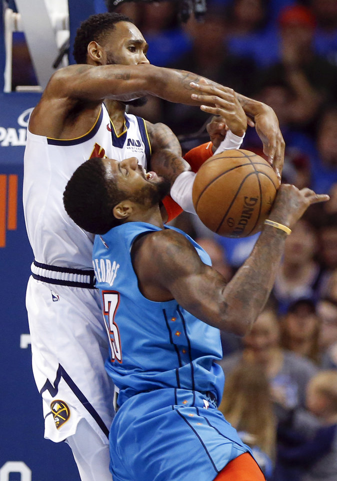 Photo - Denver's Will Barton (5) fouls Oklahoma City's Paul George (13) as he defends in the fourth quarter during an NBA basketball game between the Denver Nuggets and the Oklahoma City Thunder at Chesapeake Energy Arena in Oklahoma City, Friday, March 29, 2019. Denver won 115-105. Photo by Nate Billings, The Oklahoman