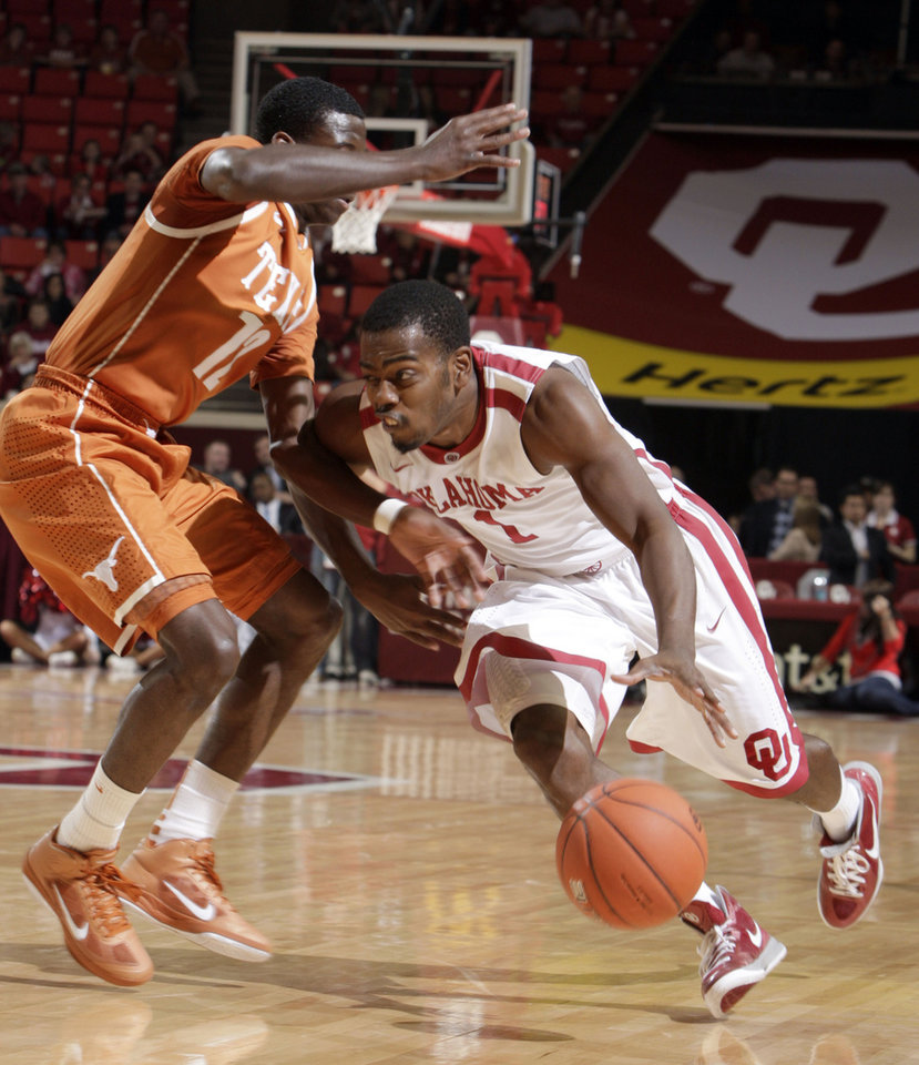 Oklahoma's Sam Grooms (1) tries to get by Texas' Myck Kabongo (12) during the NCAA men's basketball game between the University of Oklahoma and Texas University at the Lloyd Noble Center in Norman, Okla., Tuesday, Feb. 14, 2012. Photo by Sarah Phipps, The Oklahoman