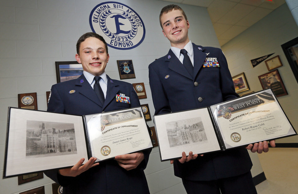 Daniel Reape, left, and Wayne Cobb, seniors in the Edmond North Air Force JROTC, show their certificates of appointment to the United States Military Academy at West Point. Photo by Nate Billings, The Oklahoman <strong>NATE BILLINGS - NATE BILLINGS</strong>