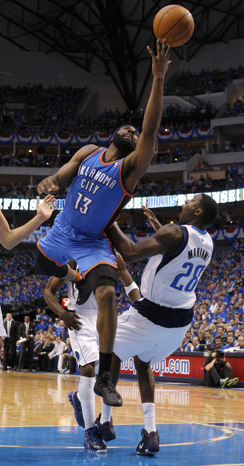 Oklahoma City's James Harden (13) shoots the ball beside Ian Mahinmi (28) of Dallas during game 2 of the Western Conference Finals in the NBA basketball playoffs between the Dallas Mavericks and the Oklahoma City Thunder at American Airlines Center in Dallas, Thursday, May 19, 2011. Photo by Bryan Terry, The Oklahoman