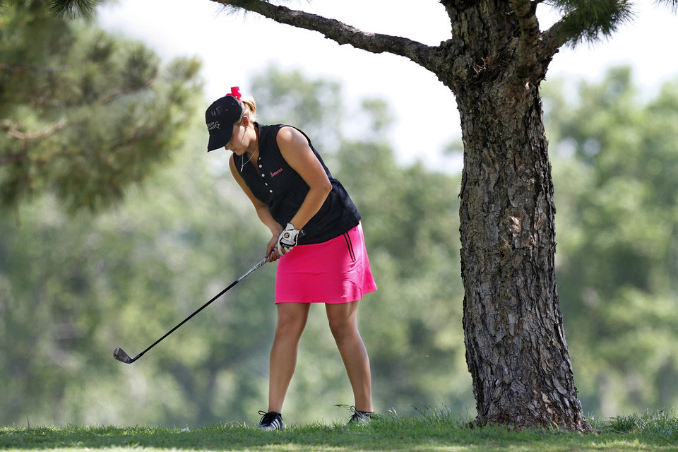 Photo - GIRLS HIGH SCHOOL GOLF / STATE TOURNAMENT: Amanda Johnson of Duncan High School hits onto the fairway from beneath a tree during Girls Class 5A State Golf Tournament at Lincoln Park Golf Course on Wednesday, May 2,  2012.    Photo by Jim Beckel, The Oklahoman