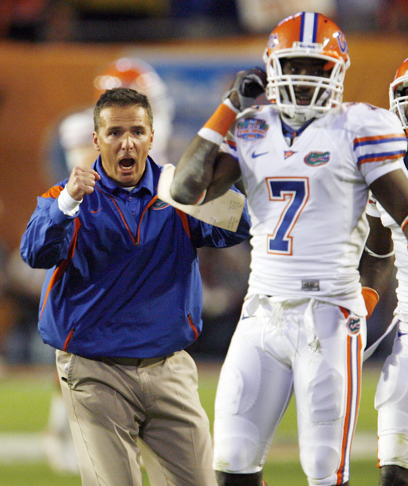 Photo - Florida head coach Urban Meyer celebrates after Florida scored the final touchdown in the fourth quarter during the BCS National Championship college football game between the University of Oklahoma Sooners (OU) and the University of Florida Gators (UF) on Thursday, Jan. 8, 2009, at Dolphin Stadium in Miami Gardens, Fla. The Florida Gators won, 24-14. PHOTO BY NATE BILLINGS, THE OKLAHOMAN
