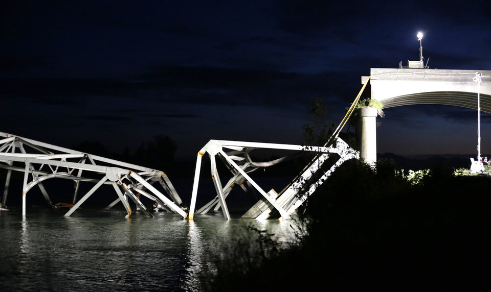Photo - The collapsed Interstate-5 bridge is seen in ruins and partially submerged in the Skagit River in Mount Vernon, Wash., Thursday, May 23, 2013. At least two vehicles went into the river in the collapse. (AP Photo/Elaine Thompson)