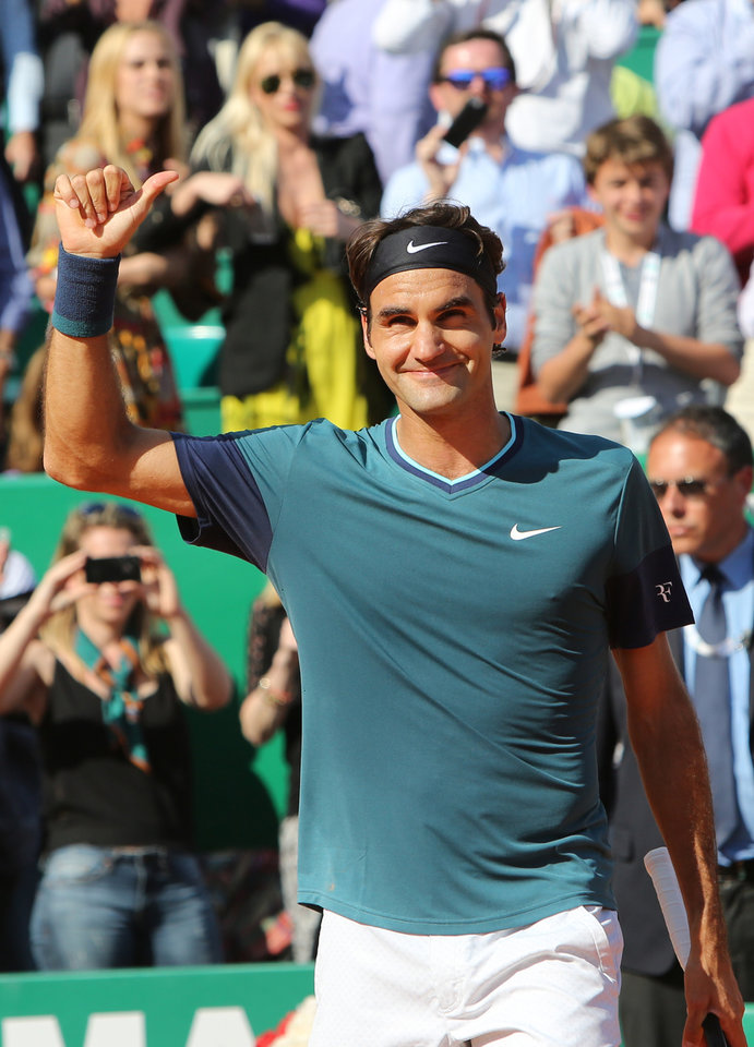 Photo - Roger Federer of Switzerland  acknowledges applause after defeating Novak Djokovic of Serbia, in their semifinal match of the Monte Carlo Tennis Masters tournament, in Monaco, Saturday, April, 19, 2014. Federer won 7-6, 6-2. (AP Photo/Claude Paris)