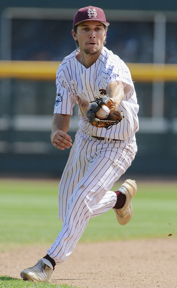Photo - Mississippi State shortstop Adam Frazier fields a ground ball hit by Oregon State's Kavin Keyes in the sixth inning of an NCAA College World Series baseball game in Omaha, Neb., Friday, June 21, 2013. Keyes was out on the play. (AP Photo/Eric Francis)