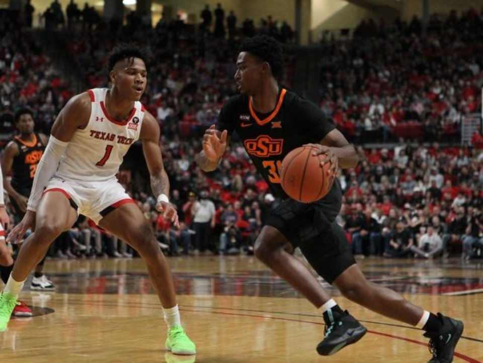Photo -  Oklahoma State guard Dee Mitchell (31) works the ball against Texas Tech guard Terrence Shannon Jr. (1) in the second half at United Supermarkets Arena in Lubbock on Jan. 4, 2020. [Michael C. Johnson/USA TODAY Sports]