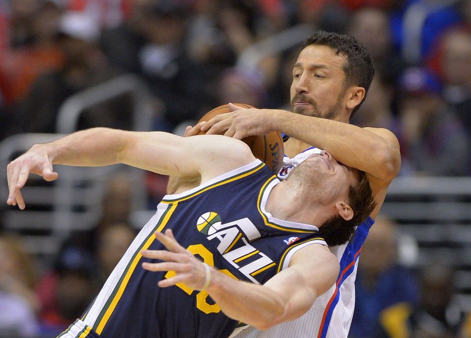 Photo - Los Angeles Clippers forward Hedo Turkoglu, top, of Turkey, rips the ball away from Utah Jazz guard Gordon Hayward during the second half of an NBA basketball game, Saturday, Feb. 1, 2014, in Los Angeles . (AP Photo/Mark J. Terrill)