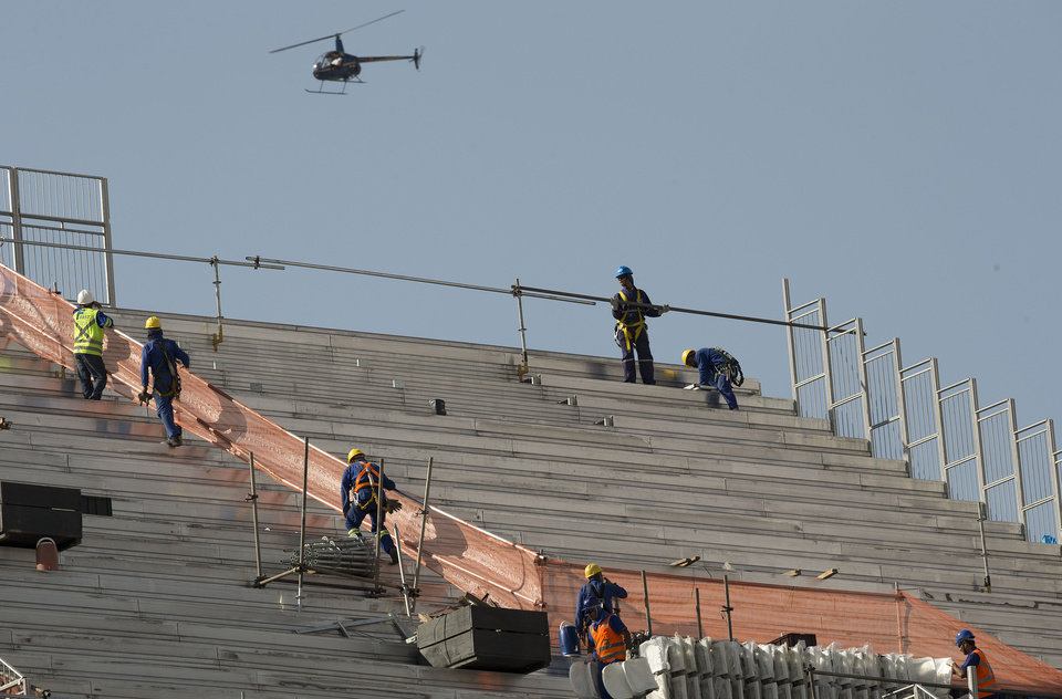 Photo - Men work on the stands of Itaquerao stadium in Sao Paulo, Brazil, Thursday, May 8, 2014. The still unfinished stadium will host the World Cup opener match between Brazil and Croatia on June 12. (AP Photo/Andre Penner)